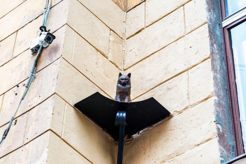 Cat figurine on building facade in St.Pesterburg stock images