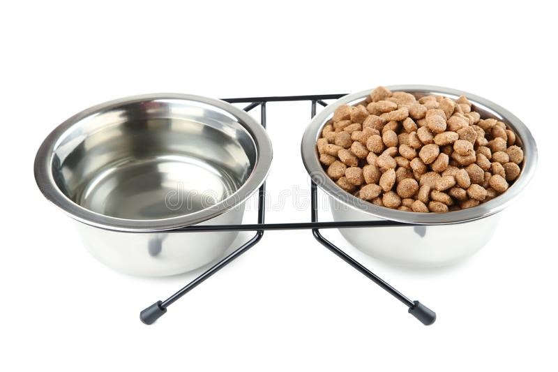 Cat food and water in bowls royalty free stock images