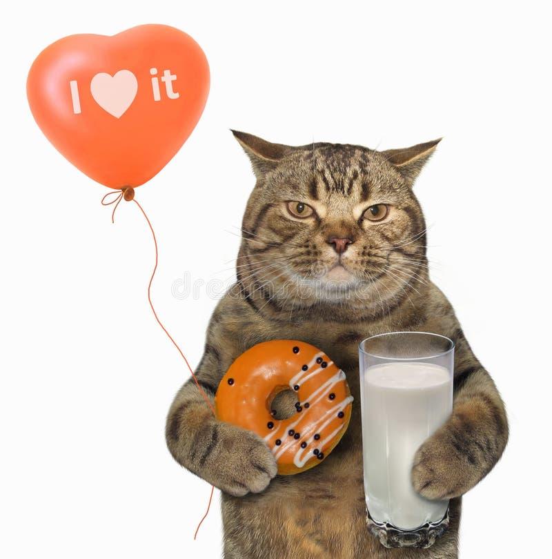 Cat with orange donut and milk stock image