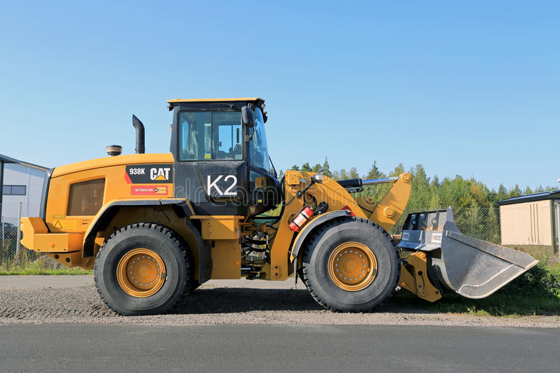 CAT 938K Wheel Loader. LIETO, FINLAND - SEPTEMBER 13, 2014: CAT 938K Wheel loader. The 938K is a small wheel loader with a Tier 4-Interim engine that can royalty free stock images
