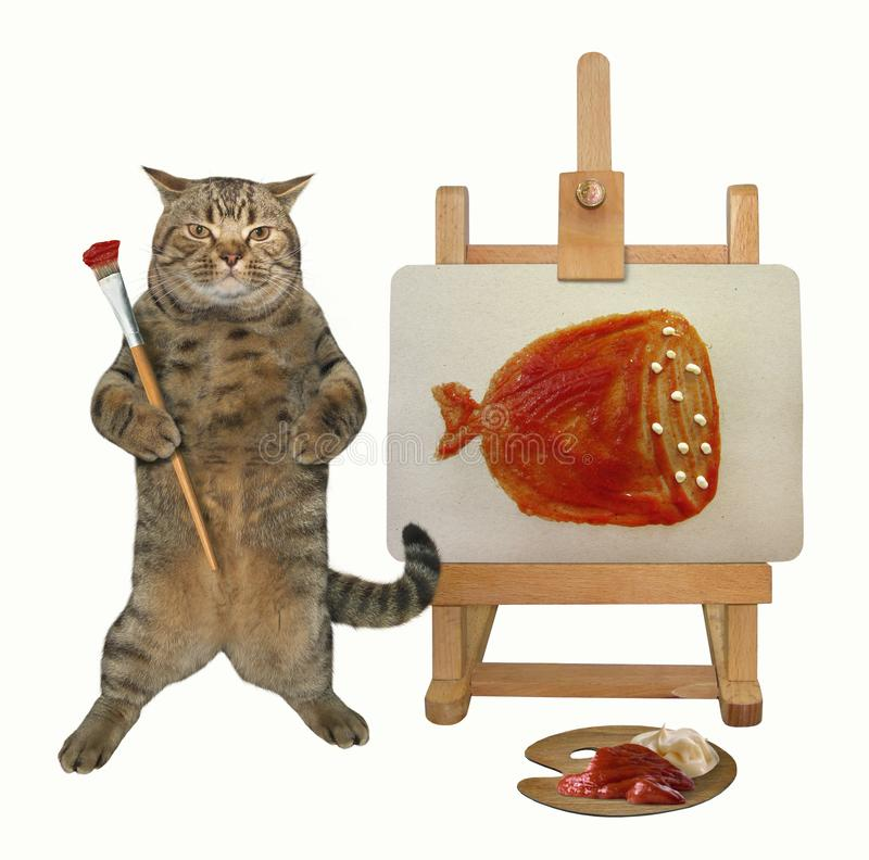 Cat draws a picture on the easel 2 stock image