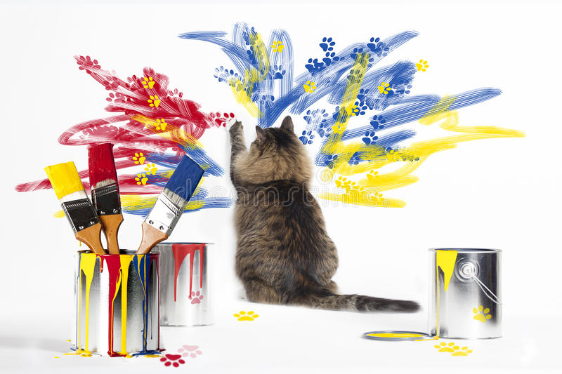 Cat Painting Wall. A brown and black striped cat sitting on white floor and painting white wall with red, yellow and blue paint. Paint cans with dripping paint stock photography