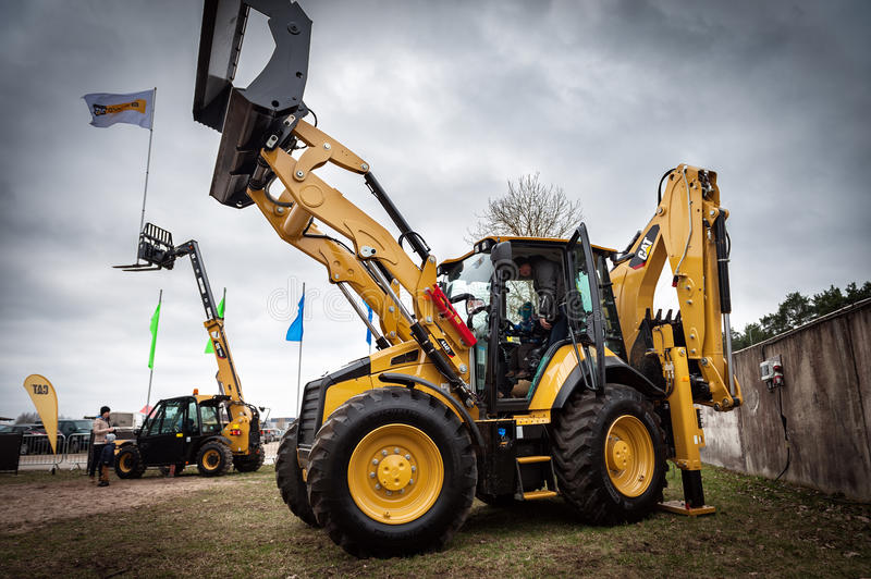 Cat tractors and other construction equipment at the public event of Riga Machinery Sales. RIGA, LATVIA - APRIL 2017: Cat tractors and other construction royalty free stock images