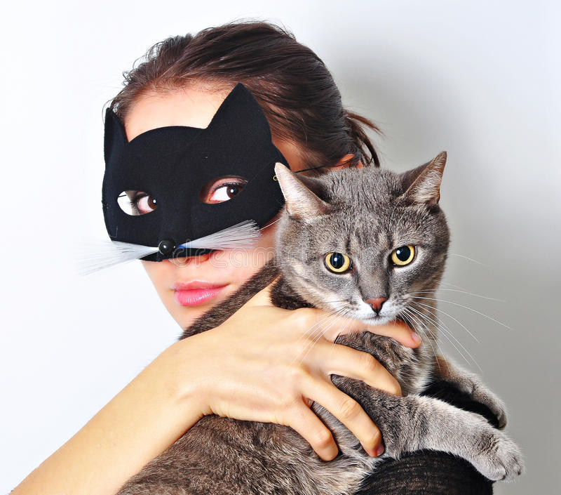 Cat woman. A girl with a cat mask on her face stock photo