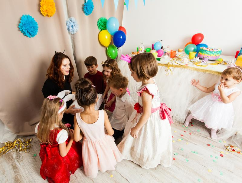 Cat woman animator. Cat women animator entertains the guests kids playing on the birthday party stock image
