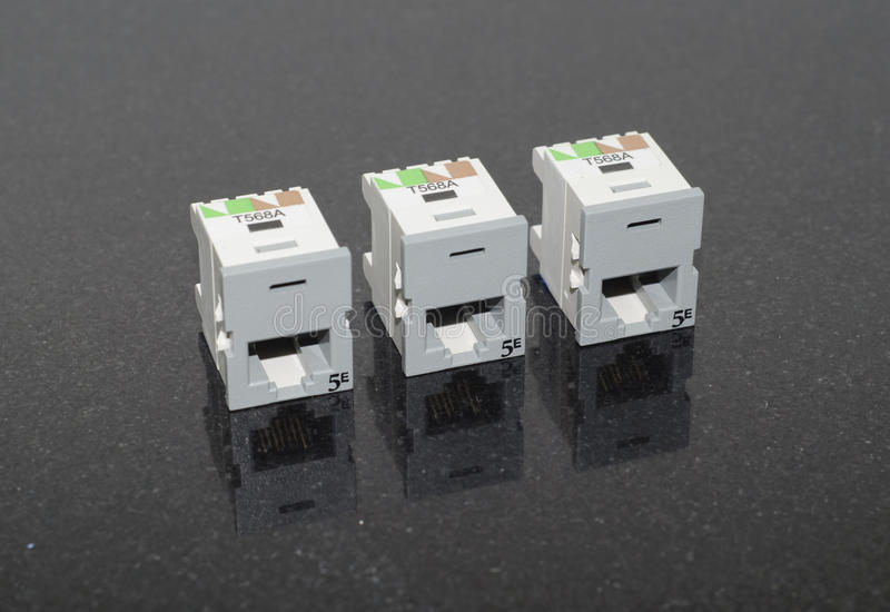 Cat5e Ethernet Jacks. Three Cat5e Ethernet Jacks for RJ45 Plugs royalty free stock image
