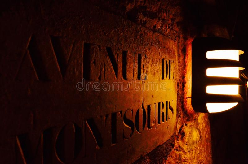 Catacombes de paris. Lampe and record stone in the tomb stock photography