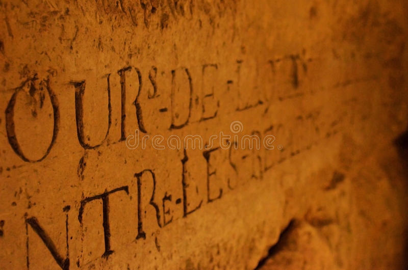 Catacombes de paris. Lampe and record stone in the tomb, in which there 6 million dead bodies because of pestilence in paris stock photo