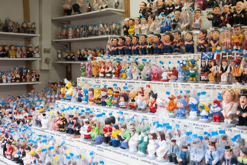 Catalan caganers för modern karikatyr på julmarknad royaltyfri foto