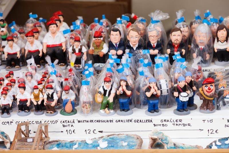 Catalan caganers för modern karikatyr på marknad arkivfoto