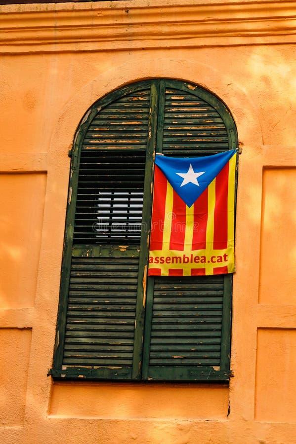 Catalan Flag hang up on the shutter in Tarragona stock photo