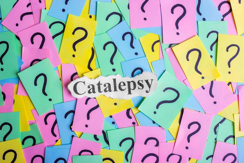 Catalepsy Syndrome text on colorful sticky notes Against the background of question marks.  royalty free stock images