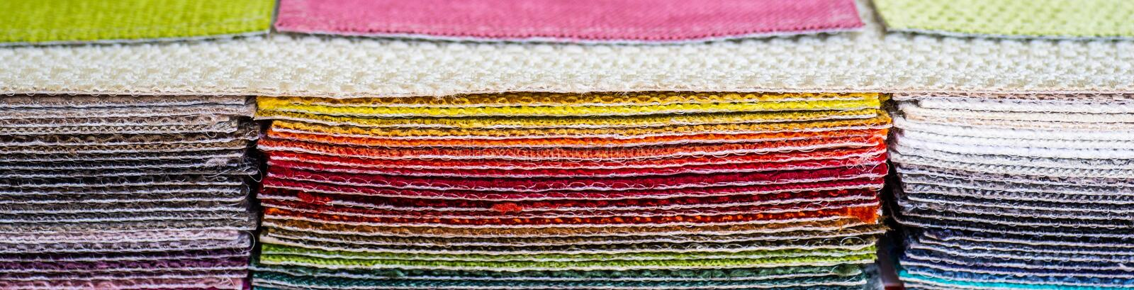 Catalog of multicolored cloth from matting fabric texture background, silk fabric texture. Textile industry background royalty free stock photos