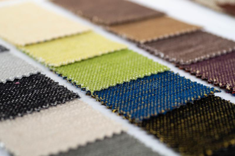 Catalog of multicolored cloth from matting fabric texture background, silk fabric texture. Textile industry background royalty free stock image