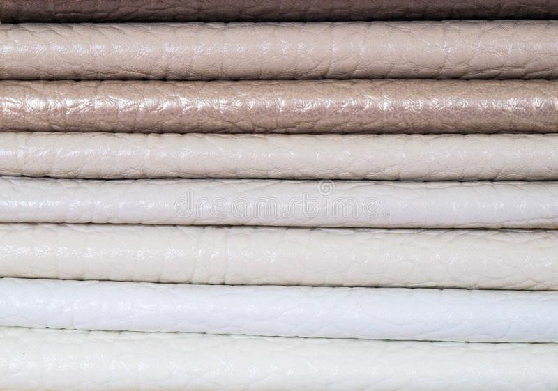 Catalog of multicolored imitation leather from matting fabric texture background, leatherette fabric texture. Industry background royalty free stock images