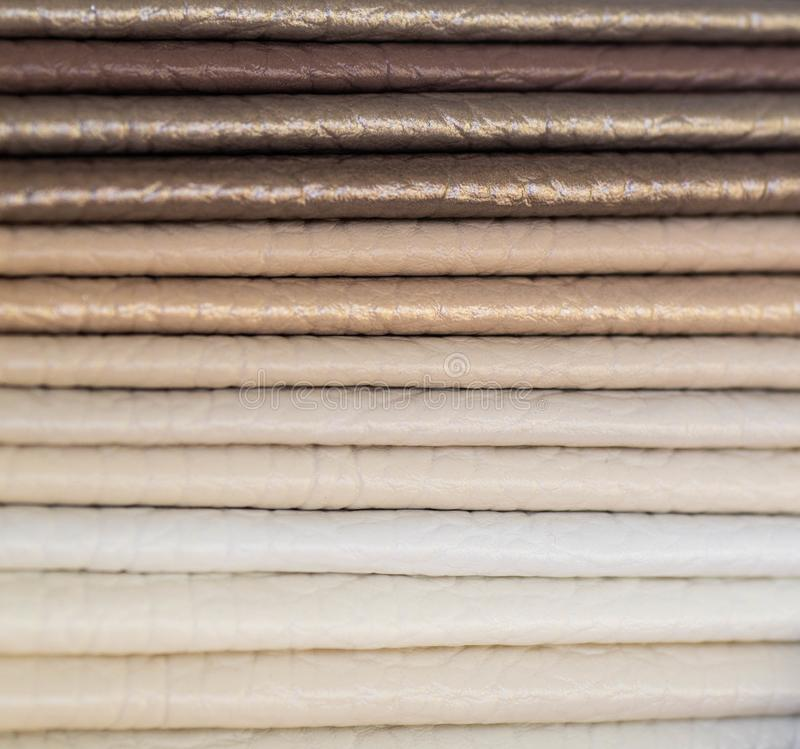 Catalog of multicolored imitation leather from matting fabric texture background, leatherette fabric texture. Industry background royalty free stock photos