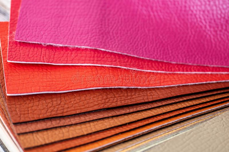 Catalog of multicolored imitation leather from matting fabric texture background, leatherette fabric texture. Industry background stock photo
