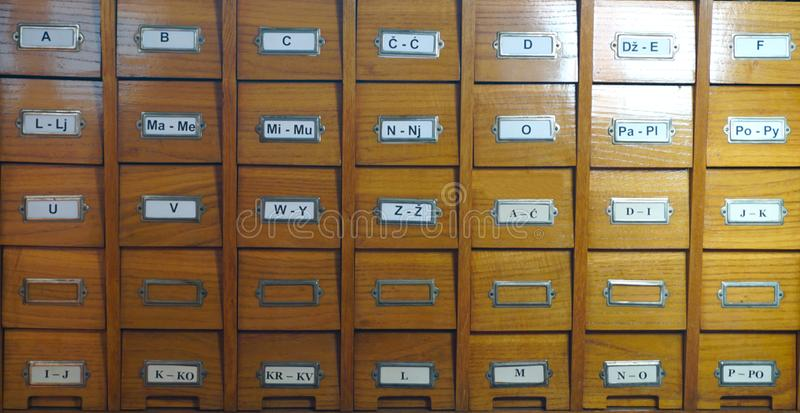 Catalogue in library. Wooden catalog in library, with letters on the box, front view stock photography