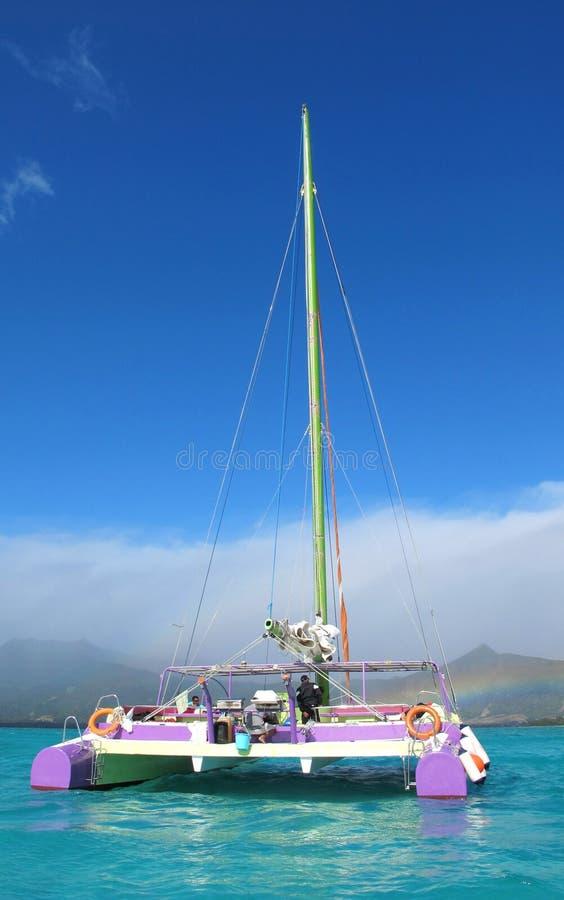 Catamaran on blue lagoon in Mauritius stock image