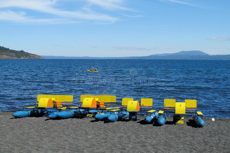 Catamaran boats for rent on a lake shore royalty free stock images
