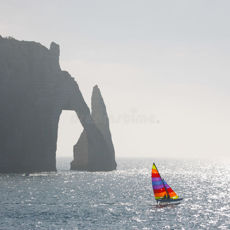Catamaran and cliff royalty free stock images