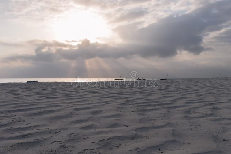 Catamaran on Diana Beach at sunrise stock photos