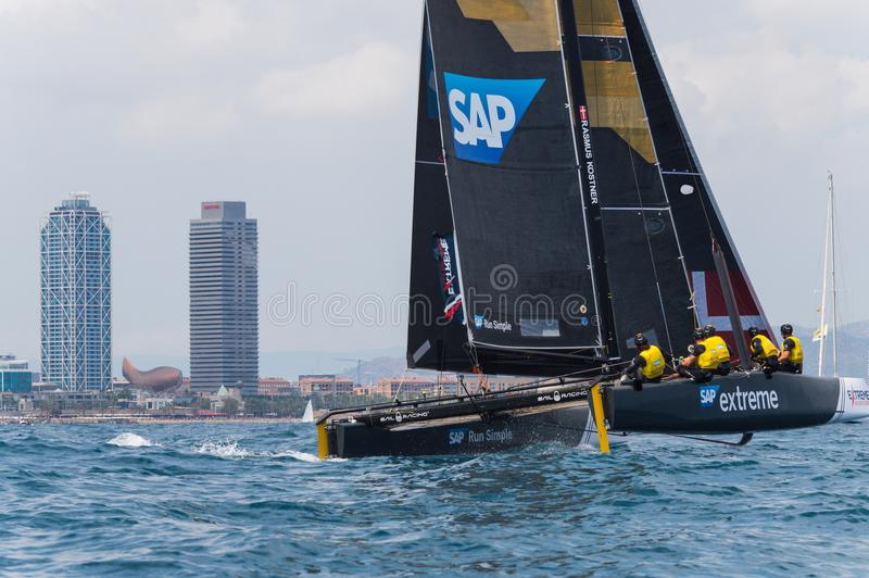 Extreme Sailing Series, Barcelona. Catamaran GC-32 sailing in front of the Mapfre towers, Barcelona royalty free stock photos