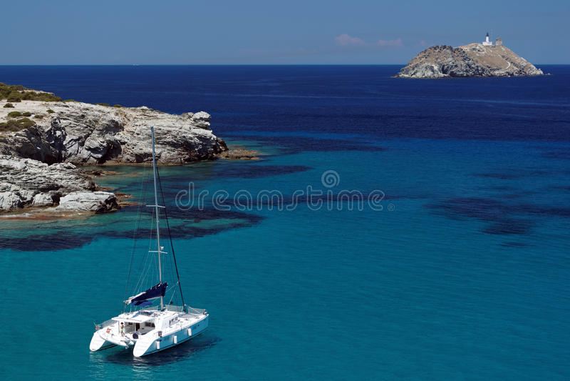 Catamaran and giraglia island royalty free stock photography