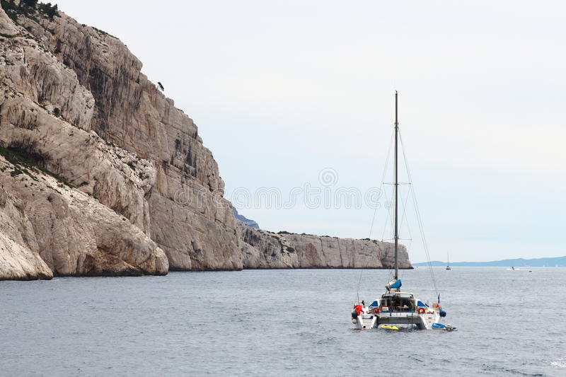 Catamaran near french calanques coast, Marseille stock photography