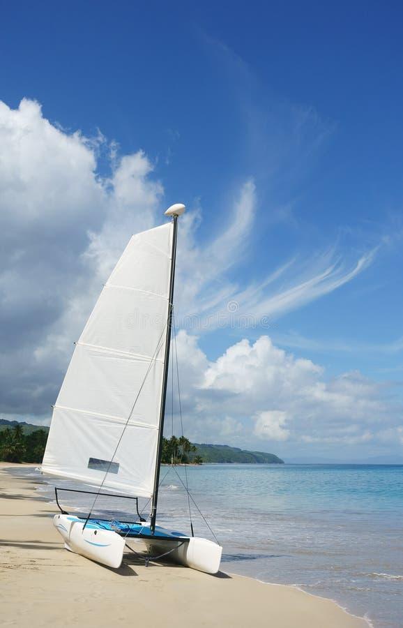 Catamaran sailboat on the beach royalty free stock images