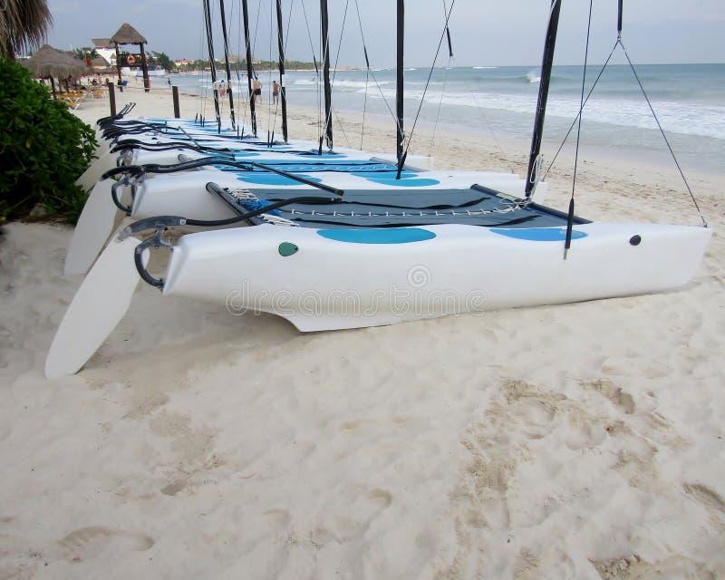 Catamaran sailboats on tropical beach of Playa del Carmen, Yucatan Peninsula, Riviera Maya. Mexico royalty free stock images