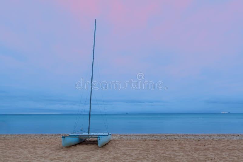 Catamaran on a sandy beach royalty free stock photography