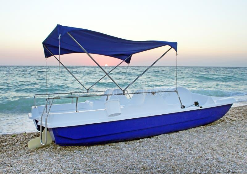 Catamaran on the sunset stock photos