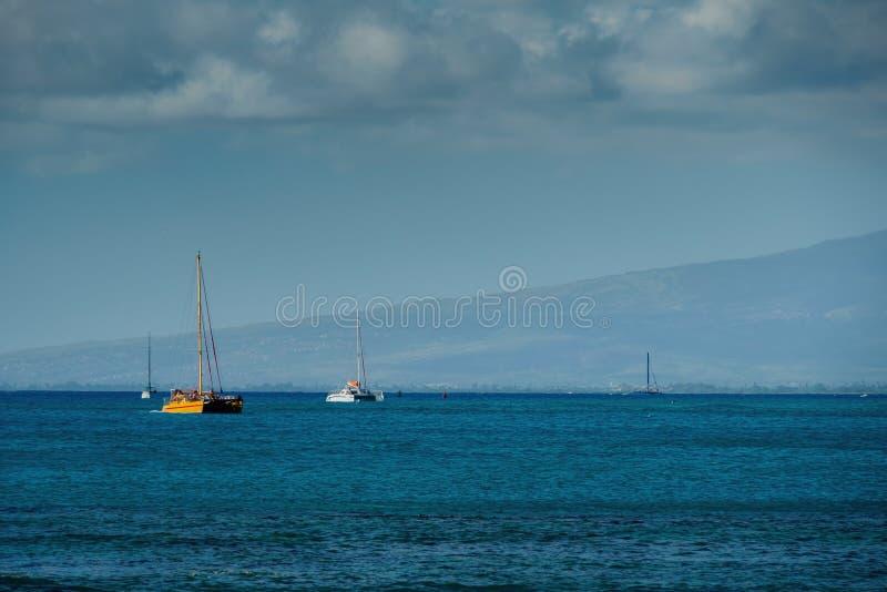 Catamaranes amarrados en la distancia fotografía de archivo libre de regalías
