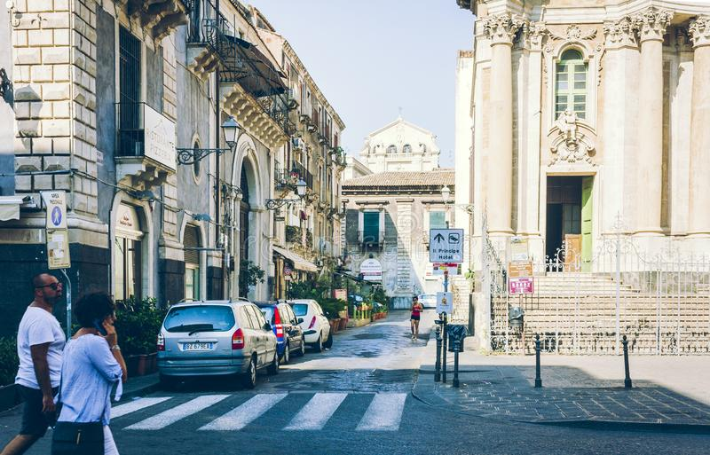 Catania, Sicily – august 14, 2018: people walk on historical street of the city, travel to Italy.  royalty free stock images
