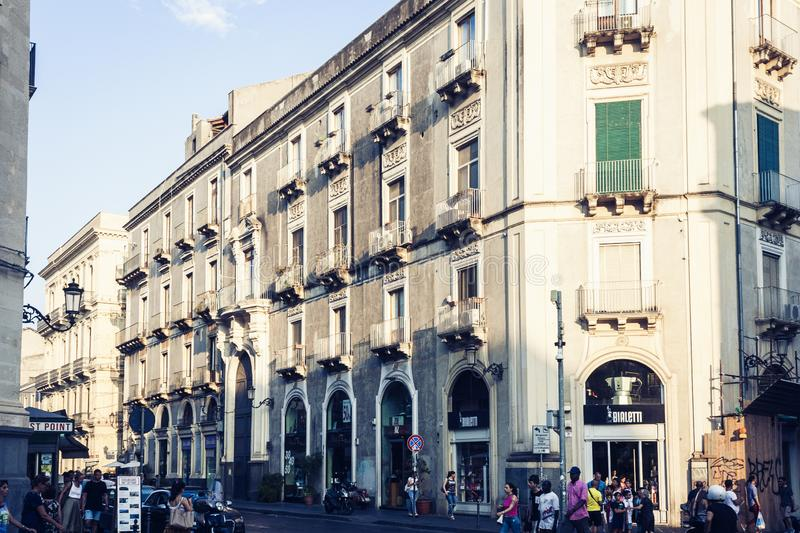 Catania, Sicily – august 9, 2018: people walk on historical street of the city, travel to Italy.  royalty free stock image
