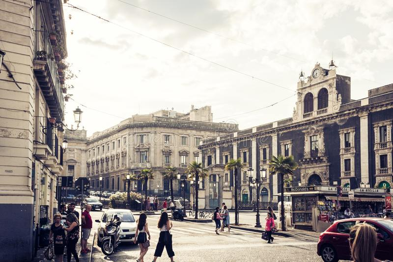 Catania, Sicily – august 8, 2018: people walk on historical street of the city, travel to Italy.  royalty free stock photo