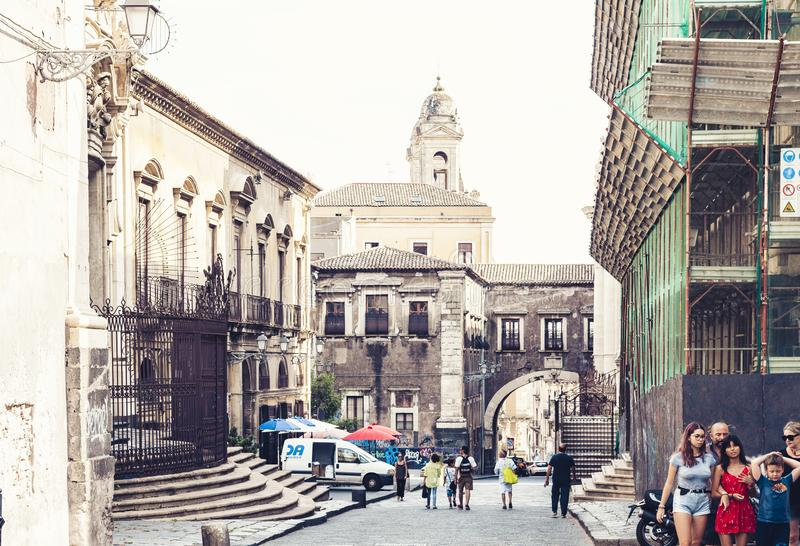Catania, Sicily – august 08, 2018: people walk on historical street of the city, travel to Italy. People walk on historical street of the city, travel to royalty free stock images
