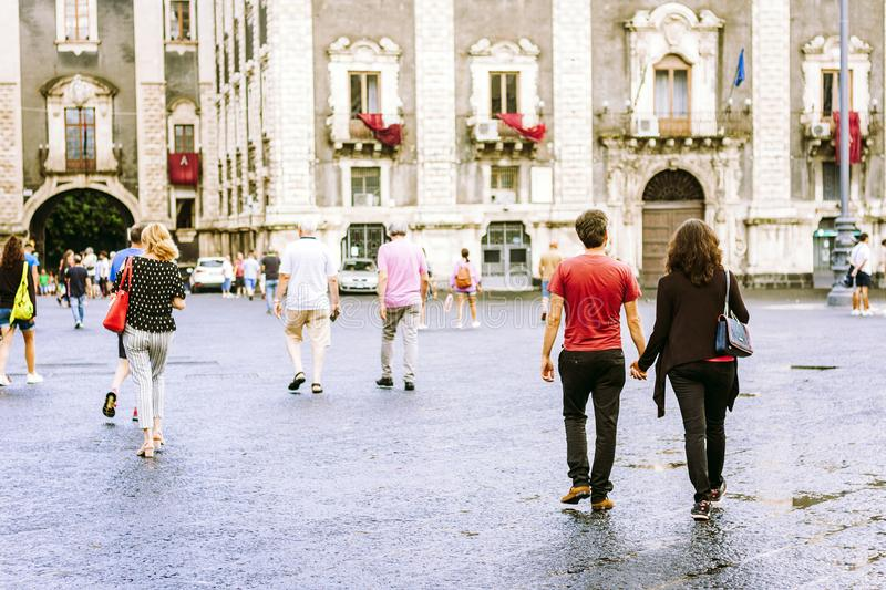 Catania, Sicily – august 15, 2018: people walk on historical street of the city, travel to Italy.  royalty free stock image