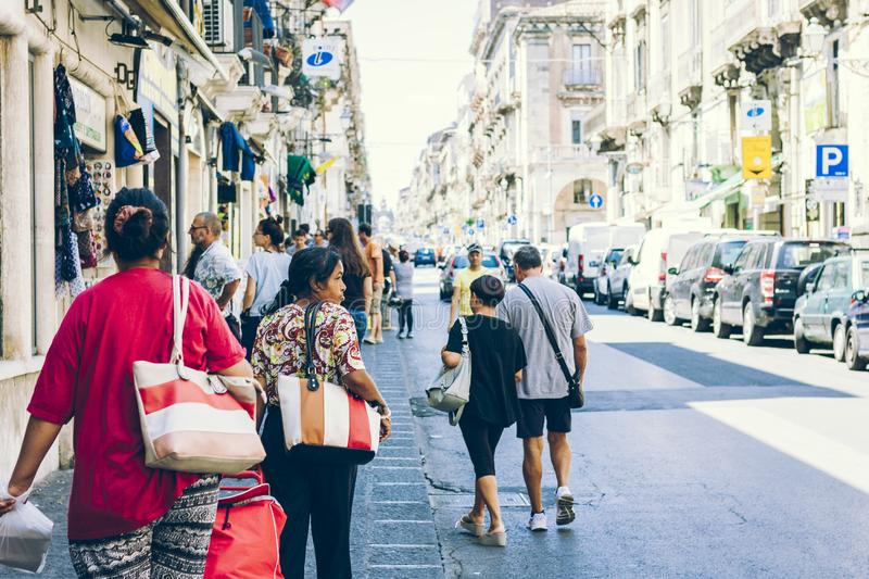 Catania, Sicily – august 16, 2018: people walk on historical street of the city, travel to Italy.  stock photo