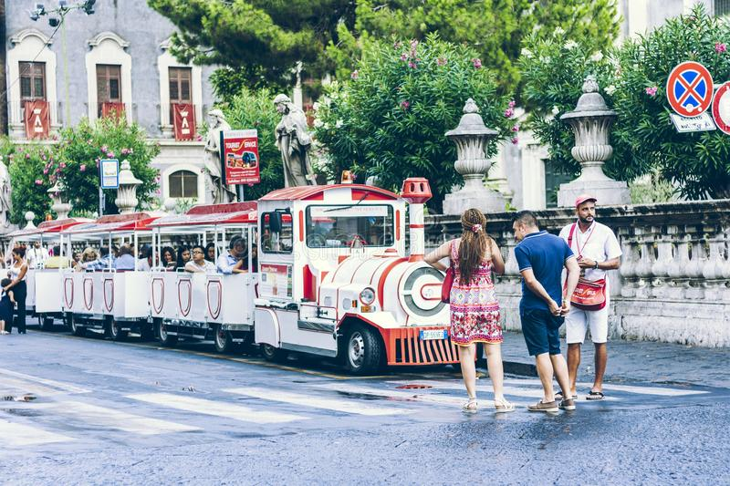 Catania, Sicily – august 15, 2018: people walk on historical street of the city, travel to Italy.  royalty free stock photography