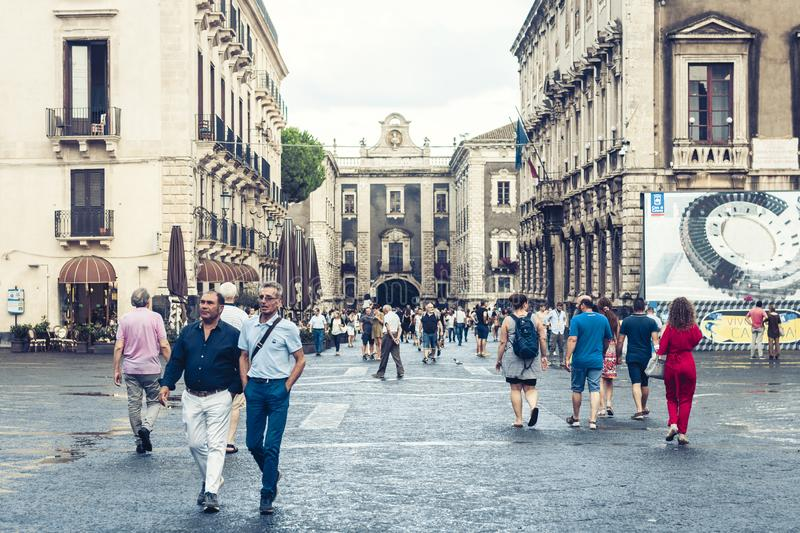 Catania, Sicily – august 15, 2018: people walk on historical street of the city, travel to Italy. People walk on historical street of the city, travel to royalty free stock photos