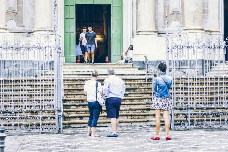 Catania, Sicily – august 15, 2018: people walk on old church, historical street of the city, travel to Italy. Catania, Sicily – august 15, 2018 stock photography