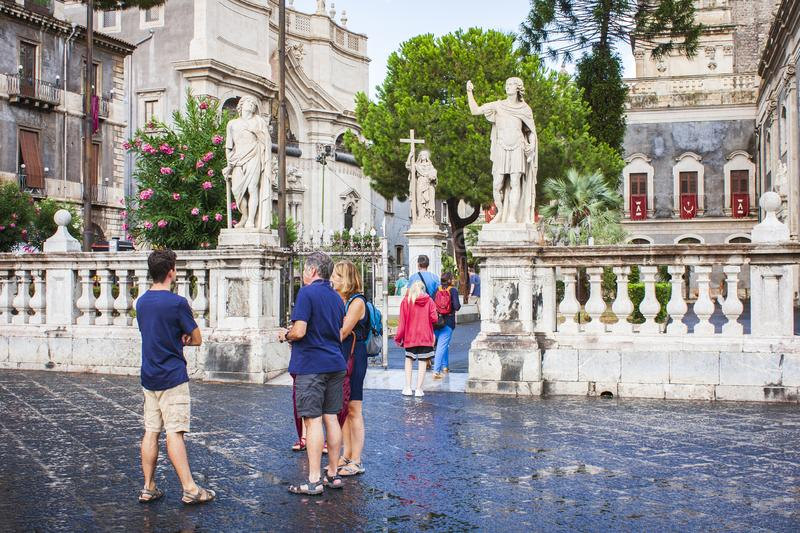 Catania, Sicily, Italy – august 15, 2018: people walk on the historical square of the city, Piazza del Duomo.  royalty free stock photography
