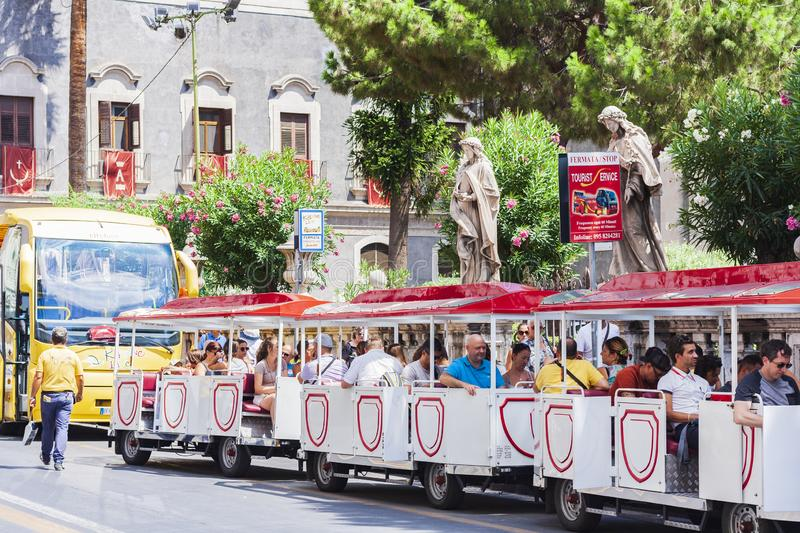 Catania, Sicily, Italy – august 16, 2018: tourists going to the bus tour to see the city sights royalty free stock images