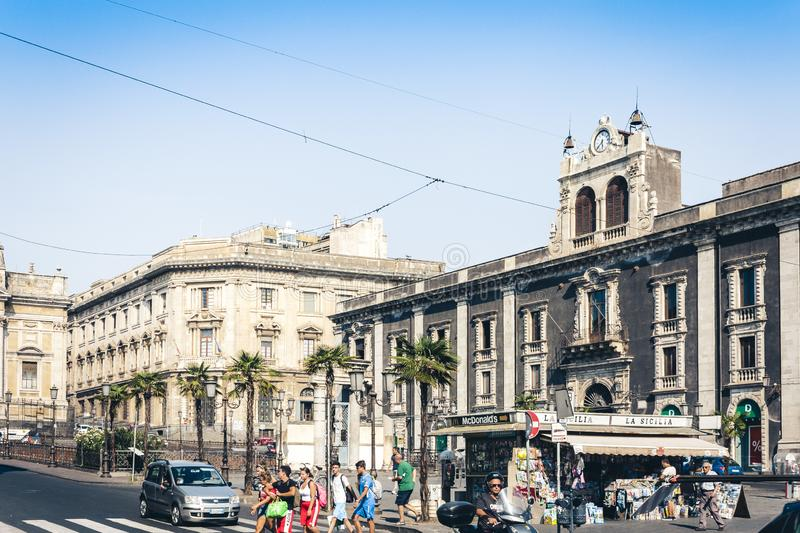 Catania, Sicily, Italy – august 14, 2018: traditional architecture, historical street with old buildings with newsstand stock photo