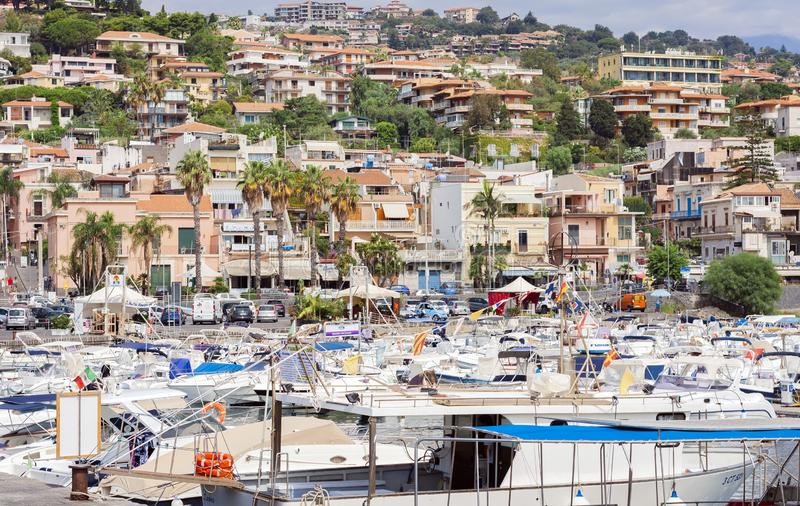 Catania, Sicily, Italy – august 08, 2018: View of Acitrezza port with fisher boats next to Cyclops islands, beautiful cityscape stock photography