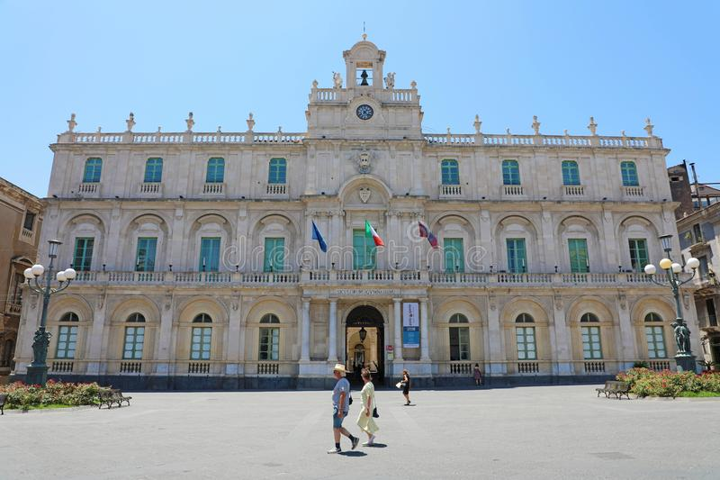 CATANIA, SICILY - JUNE 19, 2019: historical building of the oldest University in Sicily, with people walking in the place. Its. Academic nickname Siculorum royalty free stock photo