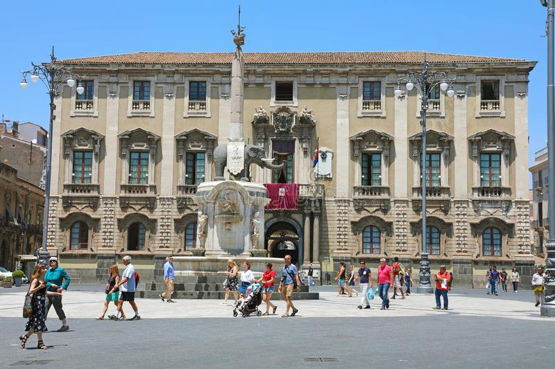 CATANIA, SICILY - JUNE 19, 2019: tourists in Piazza del Duomo square with the Elephant fountain obelisk and the city hall palace royalty free stock photography