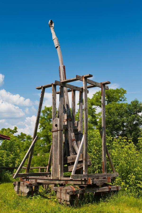 Catapult, restored model of ancient ballistic weapon, medieval siege engine. In direct sunlight stock image